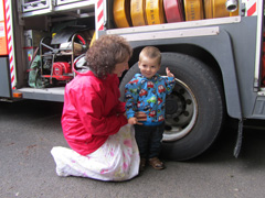 Boy in front of a fire engine